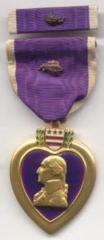 Source: http://www.45thdivision.org/Pictures/General_Knowlege/RankMedalsPatches/Medals/PurpleW1Oak.jpg